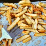 crispy fries on a pan with a spatula