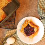German pancake topped with berry compote and maple syrup