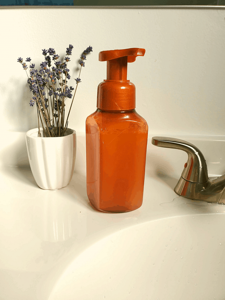 foaming hand soap and lavender on counter