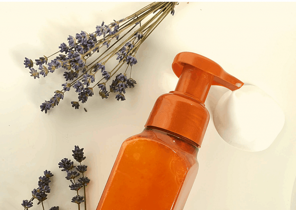 Soap dispenser and lavender on counter