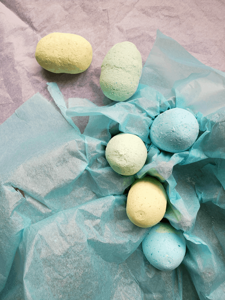 Easter egg shea butter bath bombs on decorative tissue paper
