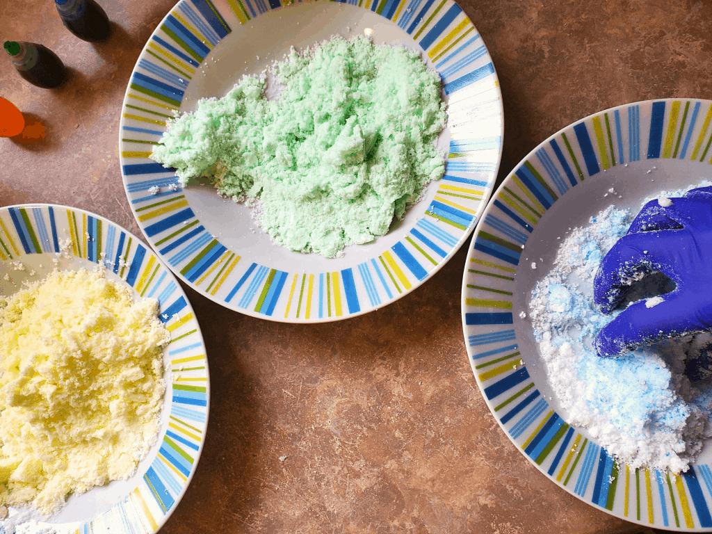 Mixing food coloring into bath bomb mixture