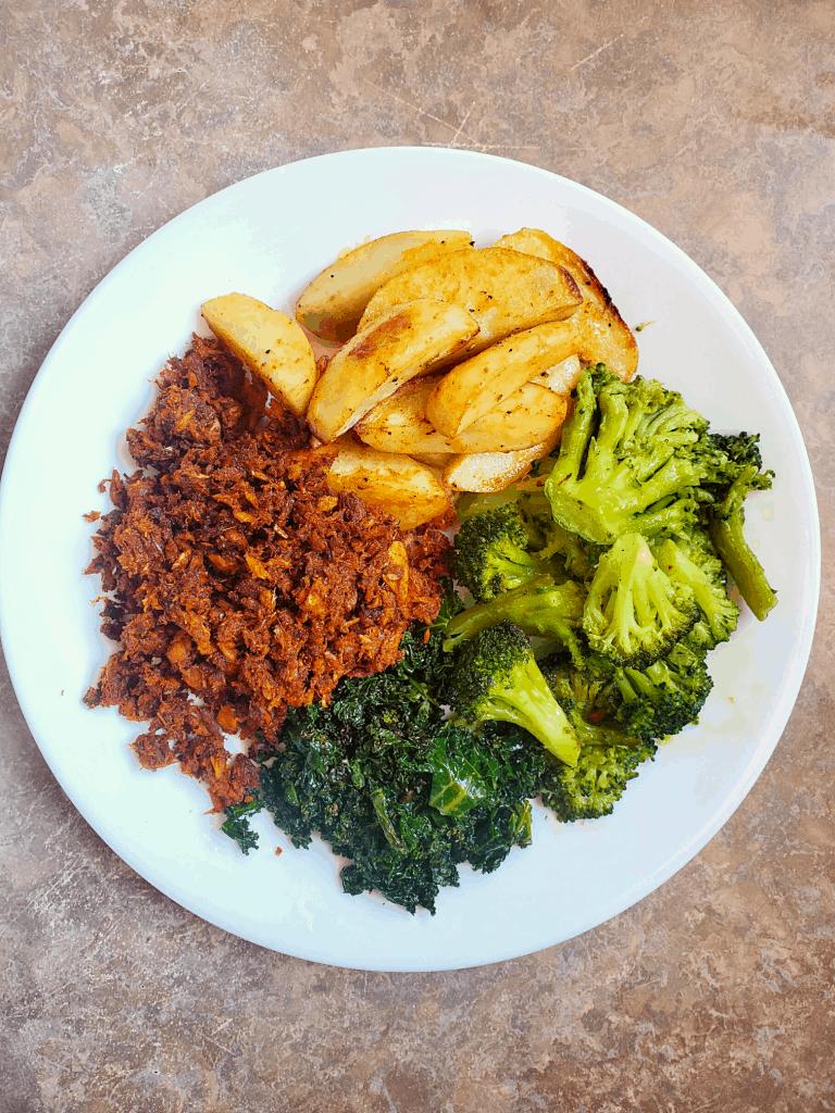 Tuna, broccoli, potatoes and kale on a plate