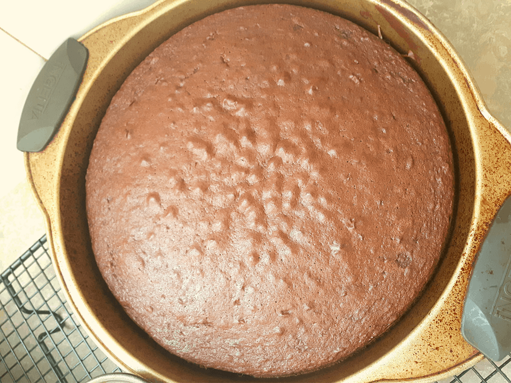 Chocolate cake in pan on cooling rack