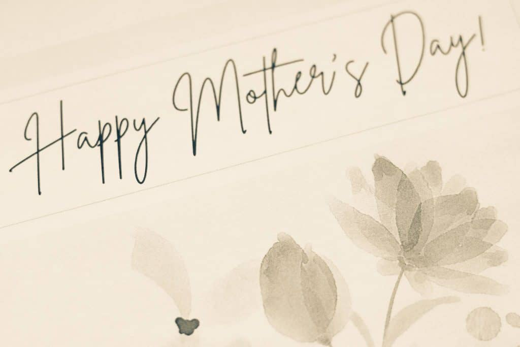 """""""Happy Mother's Day"""" and flowers on a card"""