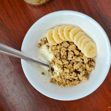 granola in a bowl with yogurt and bananas