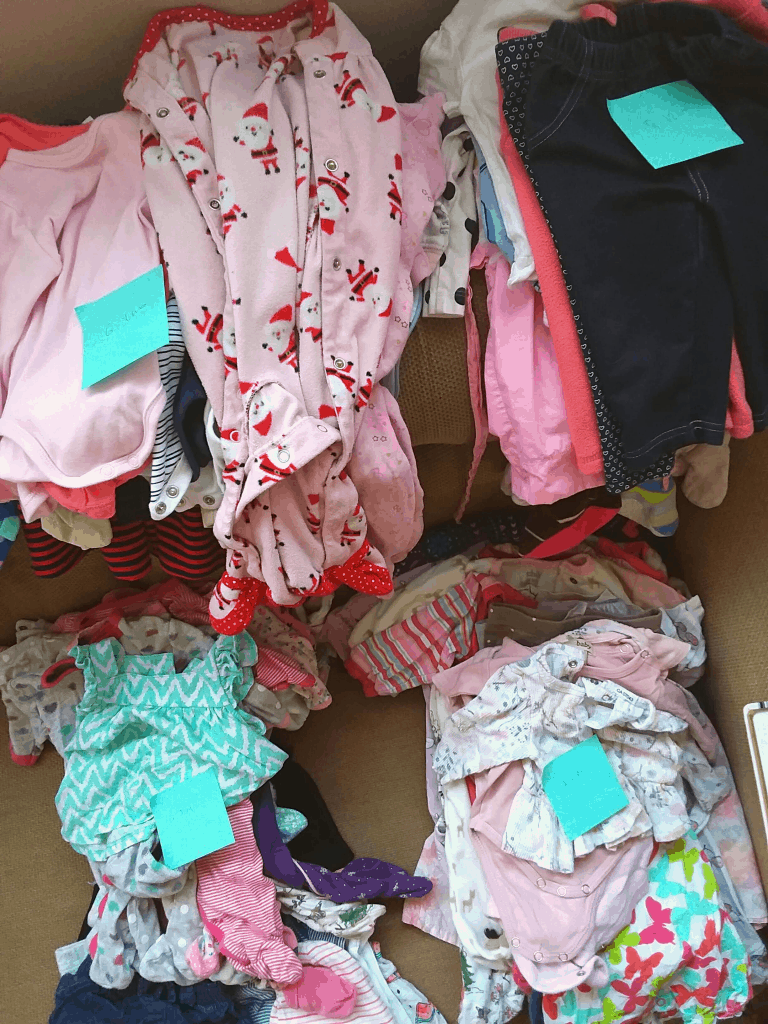 Baby clothes divided by size