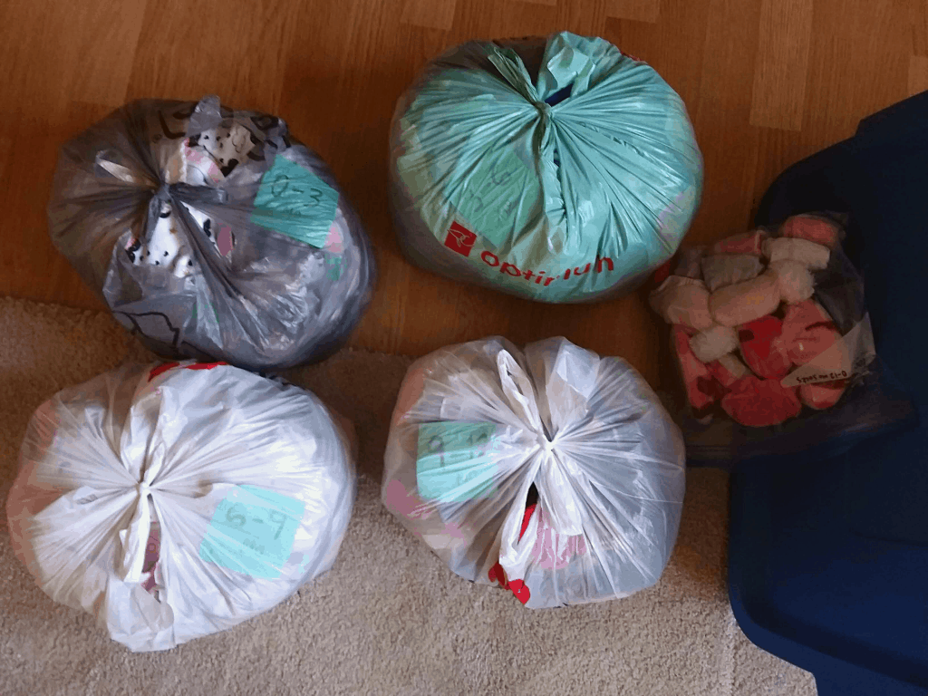 Babyy clothes in bags, ready for storage
