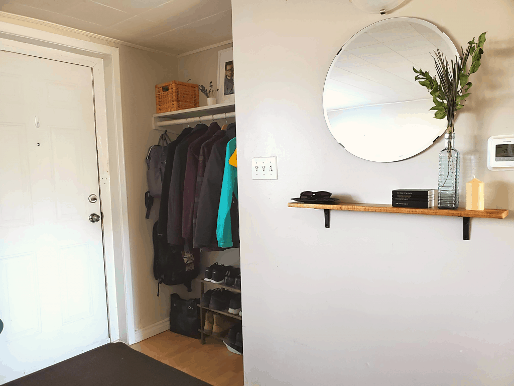 Entryway closet and hallway with mirror and shelf