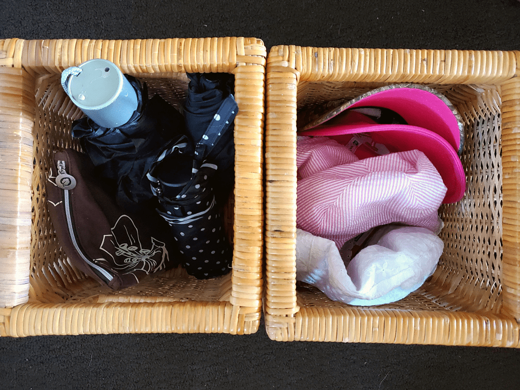 Umbrellas and hats organized in baskets for entryway