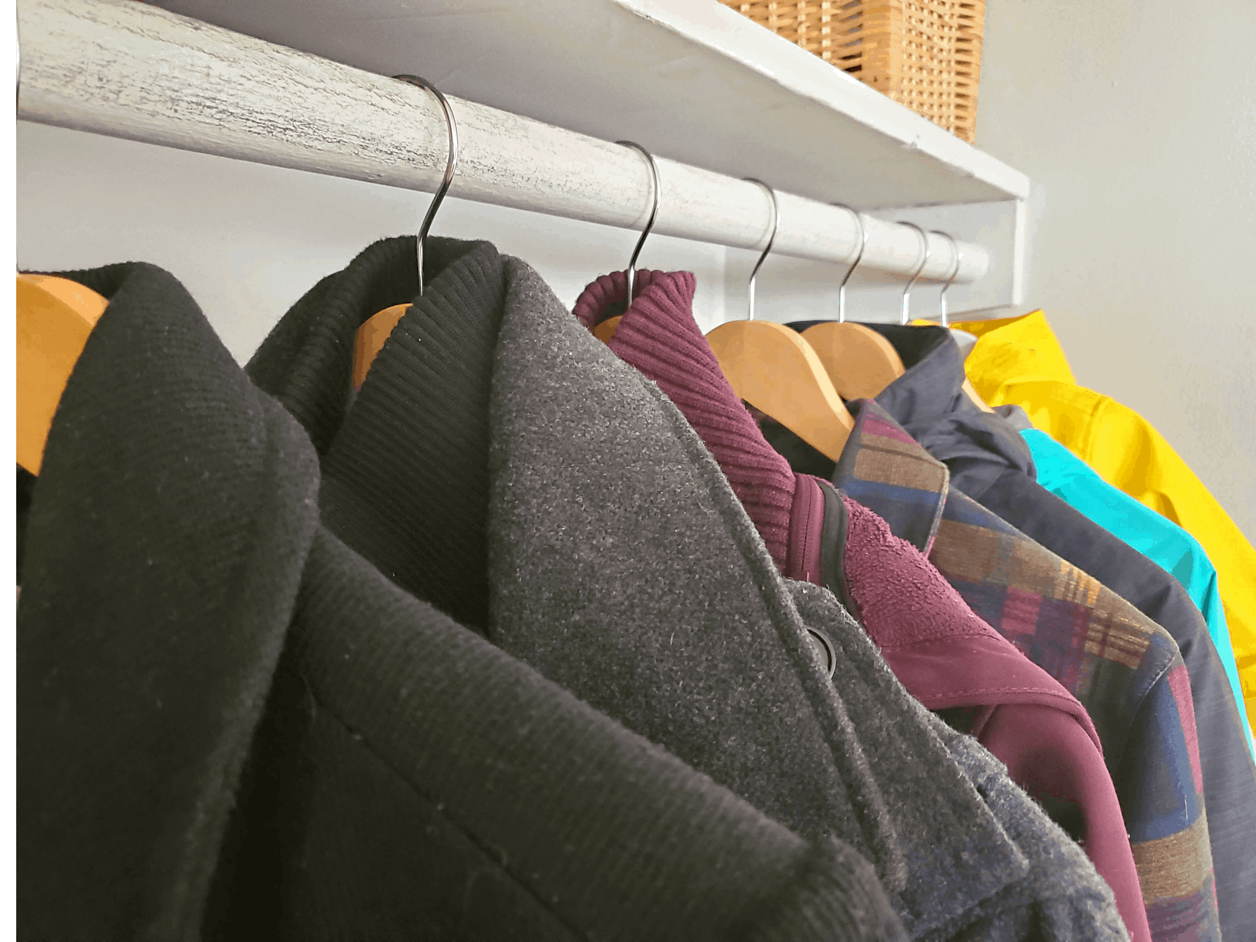 coats hanging on a rod