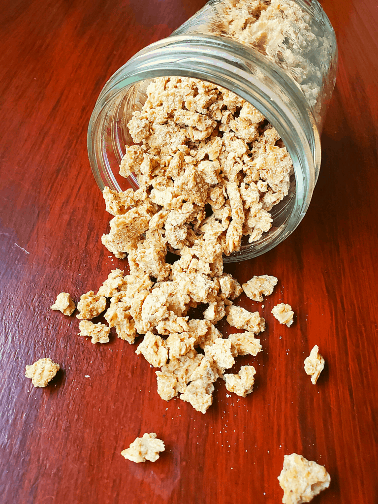Granola in a jar spilling onto a counter