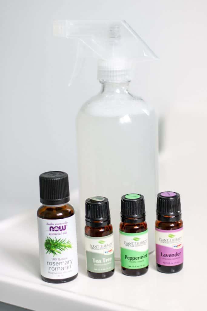 glass spray bottle and essential oil bottles