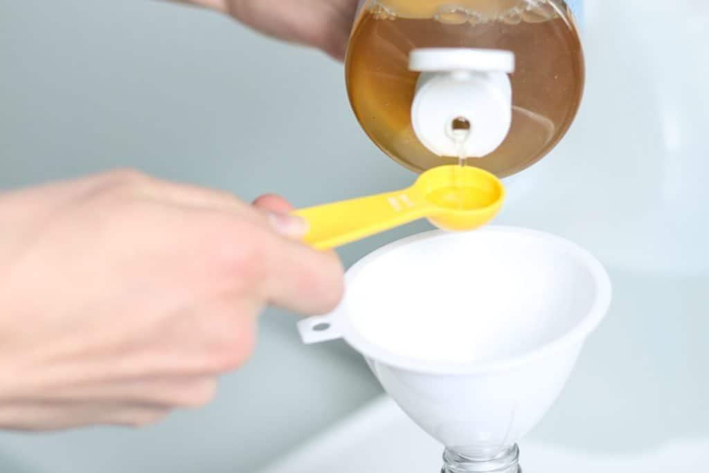 measuring castile soap for diy cleaner