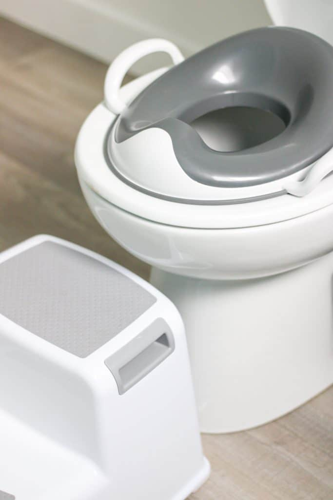 toilet seat reducer on toilet and step stool
