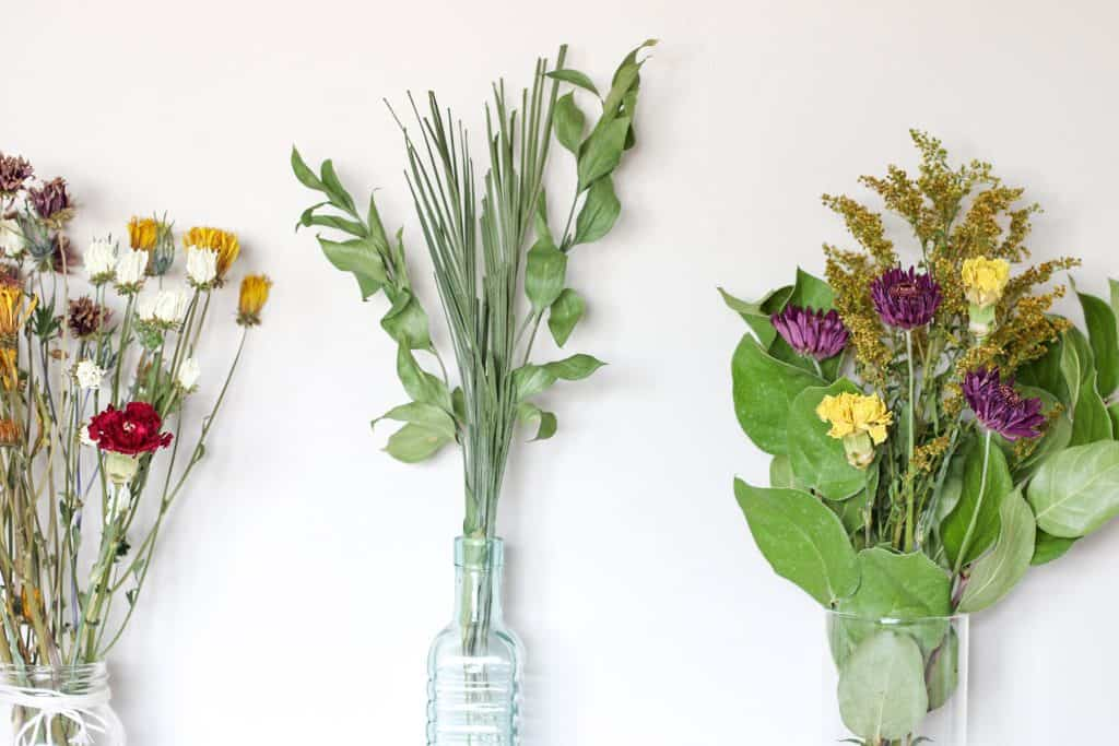 3 dried flower bouquets in vases