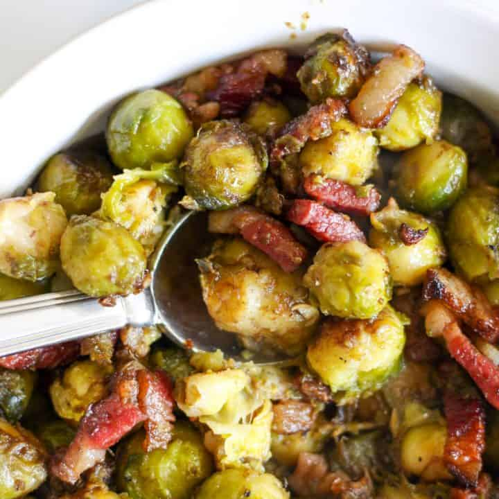 closeup of roasted brussel sprouts with bacon in a dish