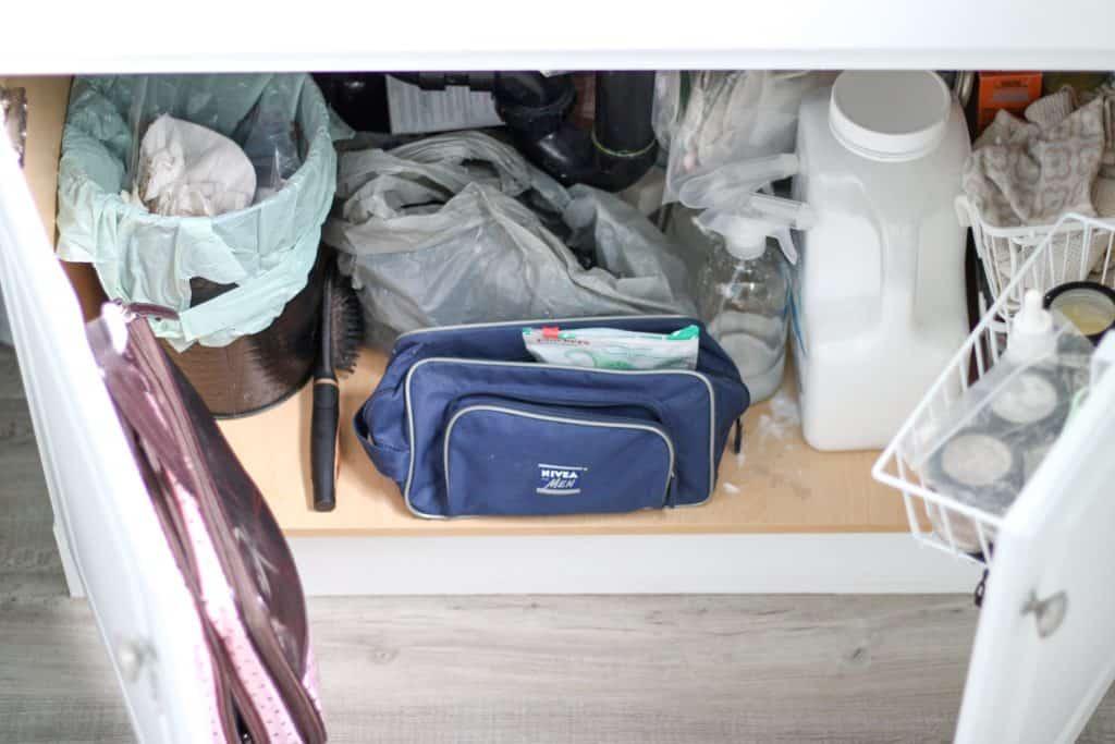 messy under sink space