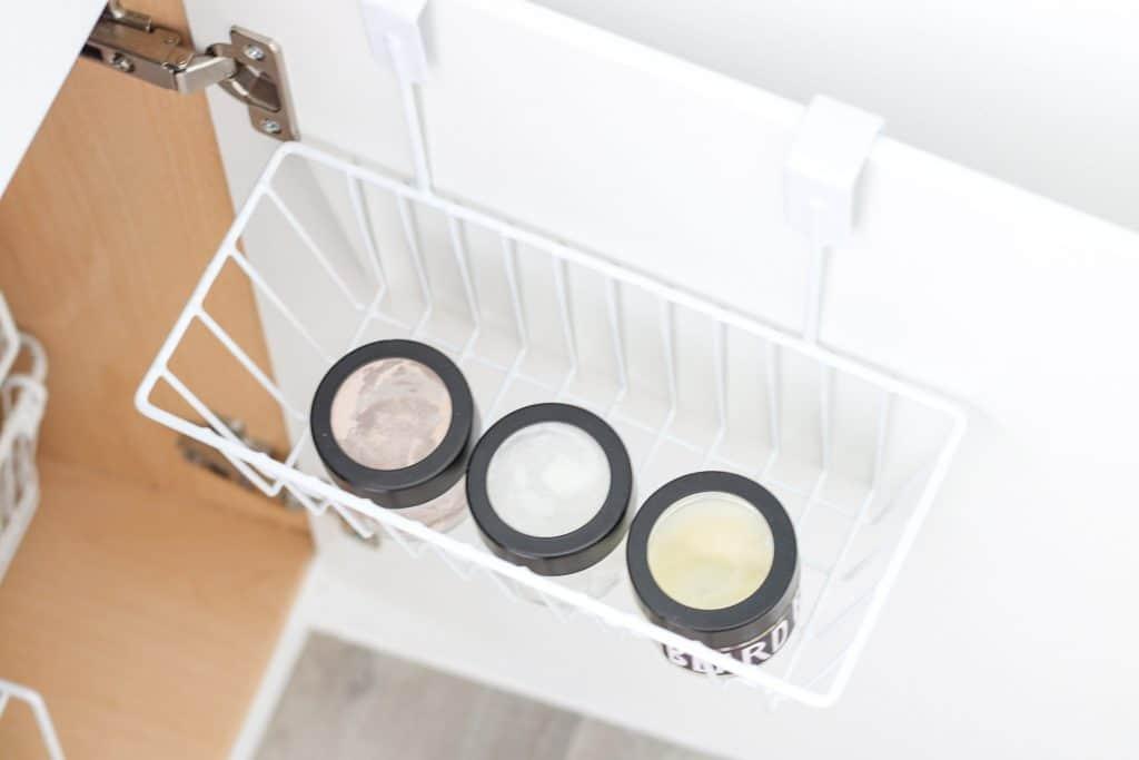 over the door basket on back of bathroom cabinet door
