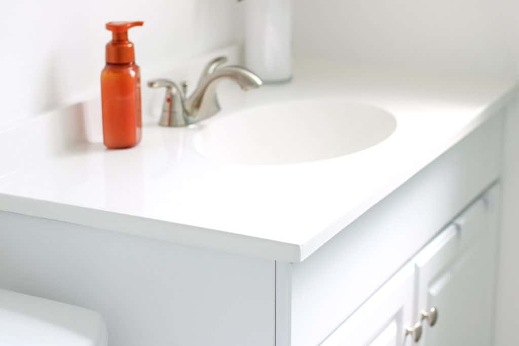 white cabinet and countertop in bathroom with minimal clutter