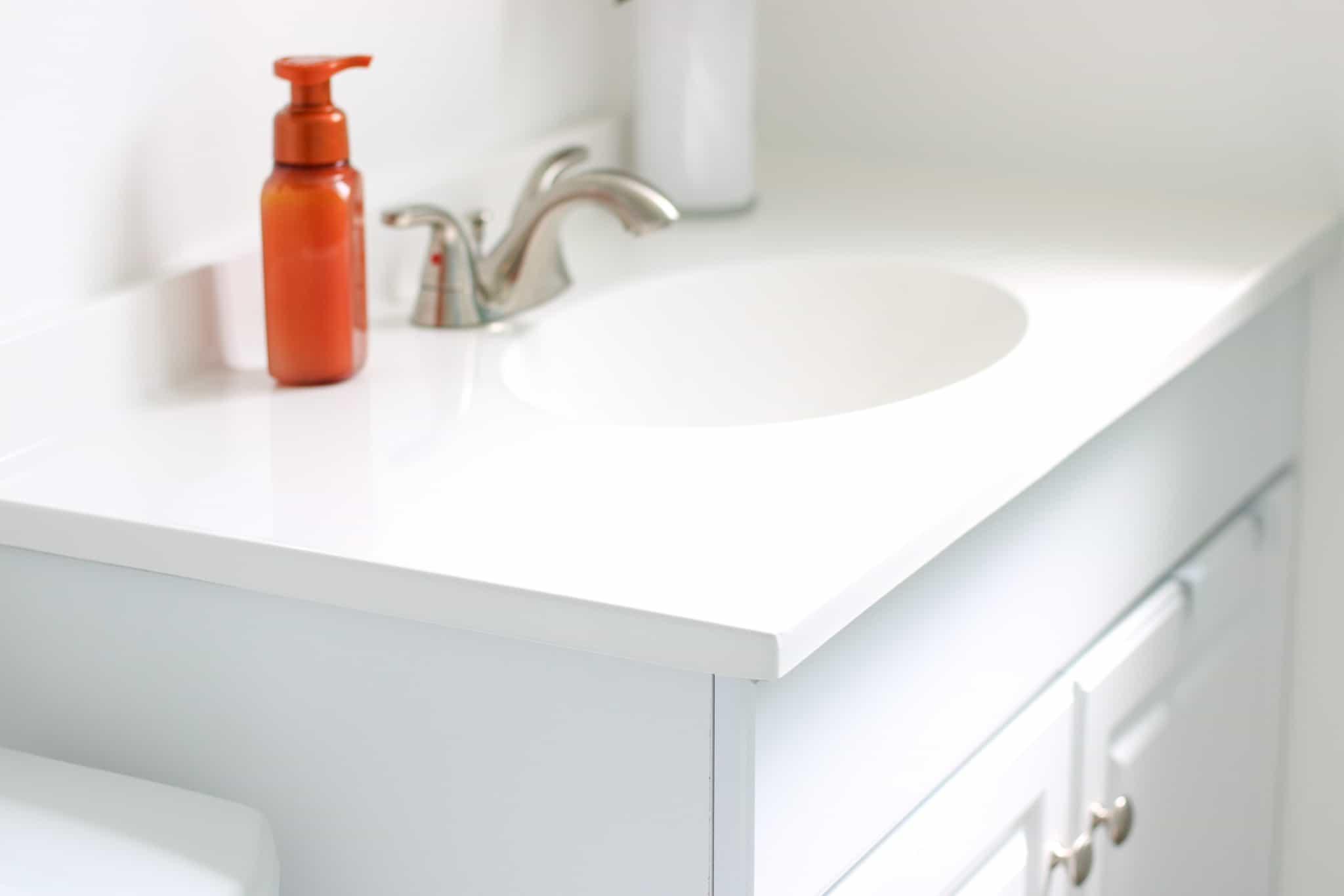 clean bathroom countertop and cupboard