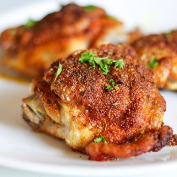 crispy baked chicken thigh on plate