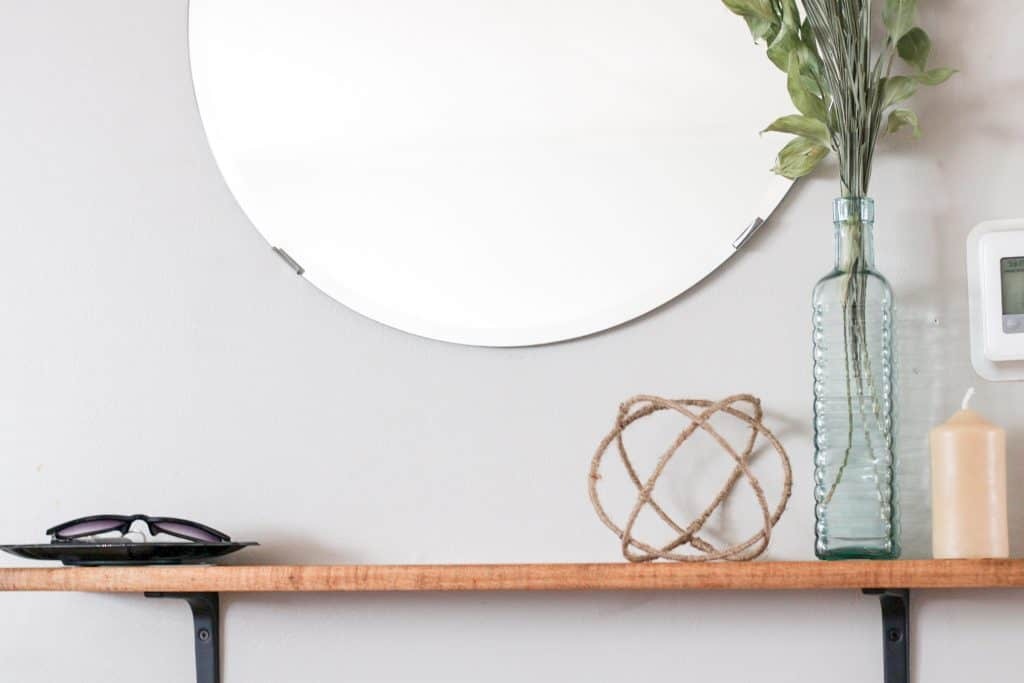 decorative sphere styled on an entry shelf