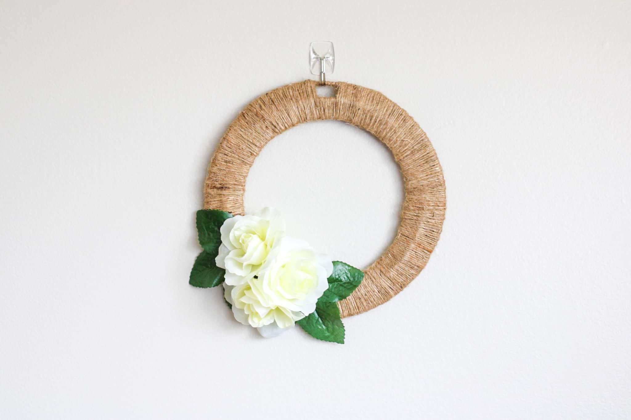 dollar tree diy wreath hung on wall