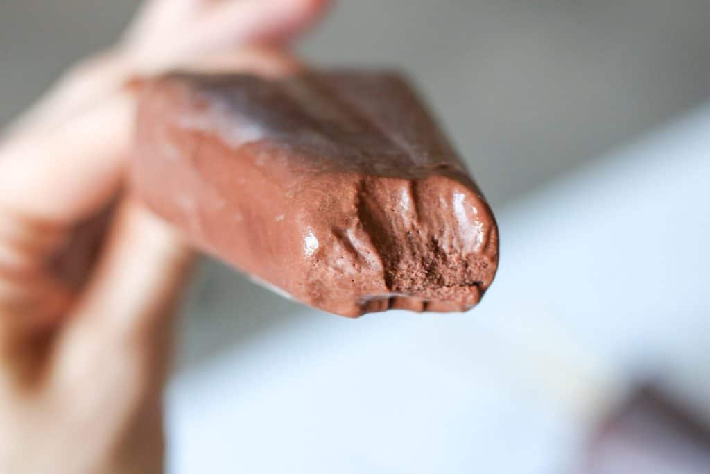 chocolate popsicle with bite taken out of it