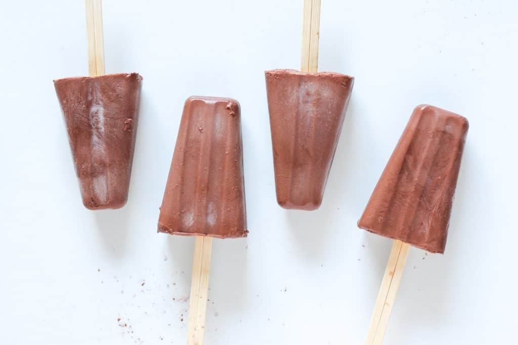 chocolate fudge popsicles lined up