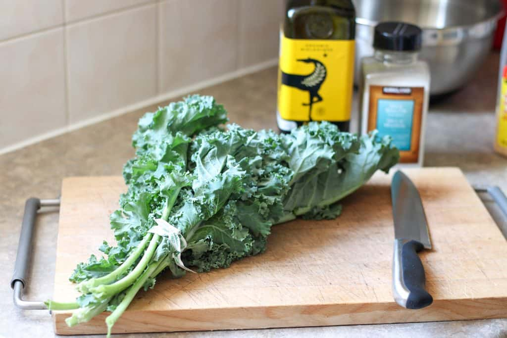 bunch of kale on cutting board with knife