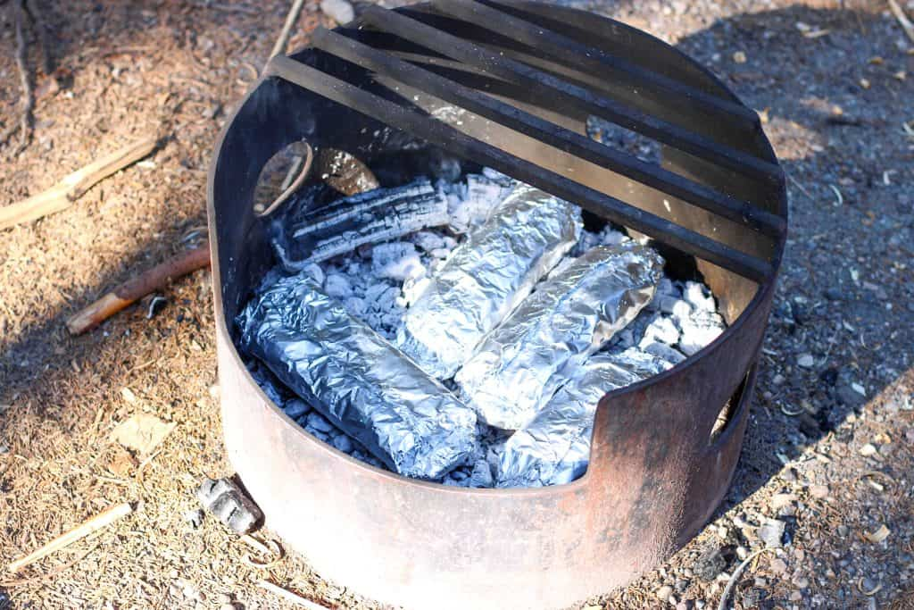 foil packet dinners cooking on hot coals