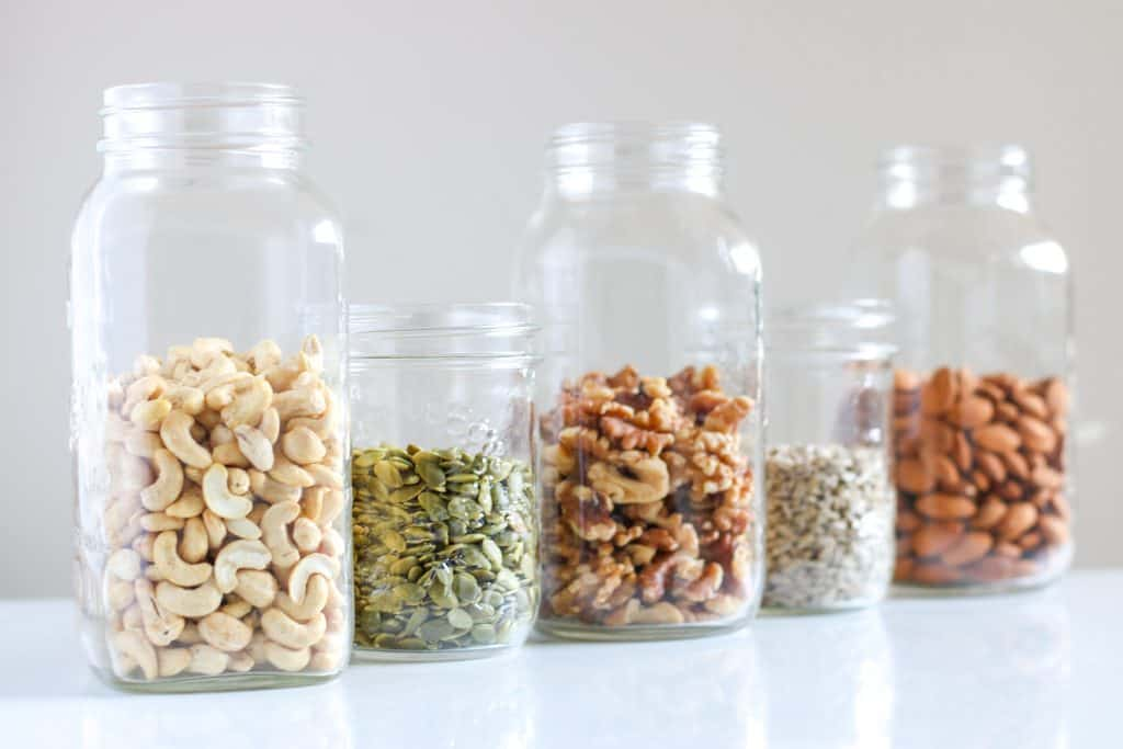 jars half filled with nuts and seeds