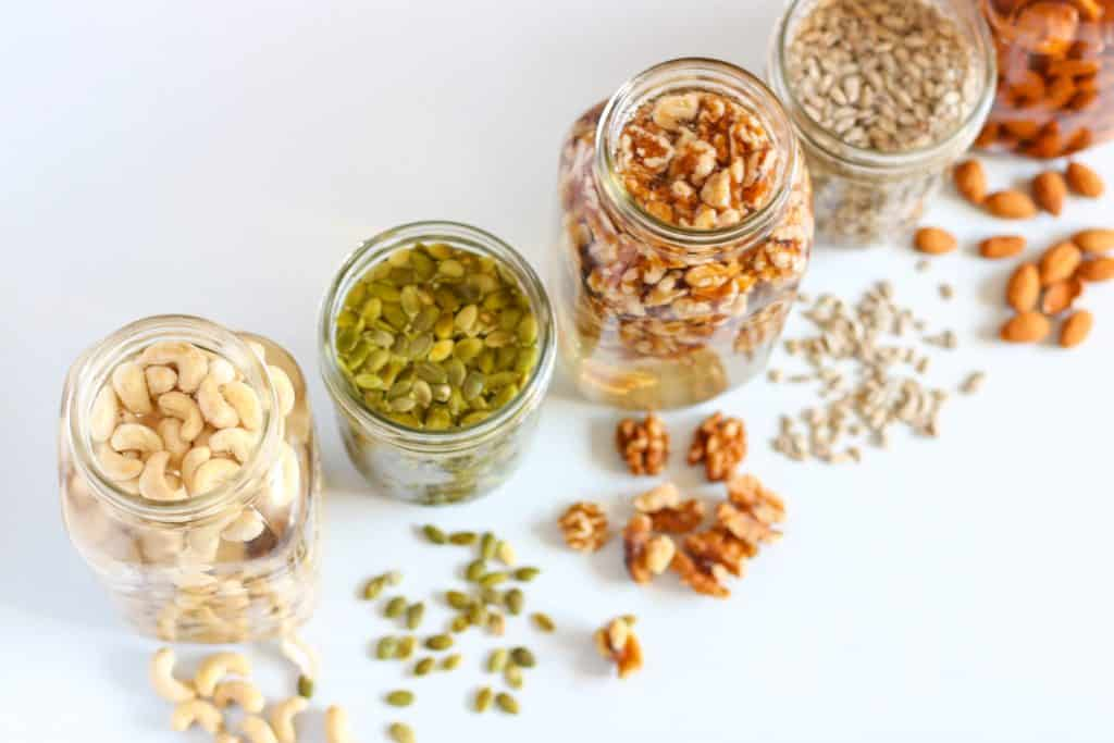 nuts and seeds soaking in jars