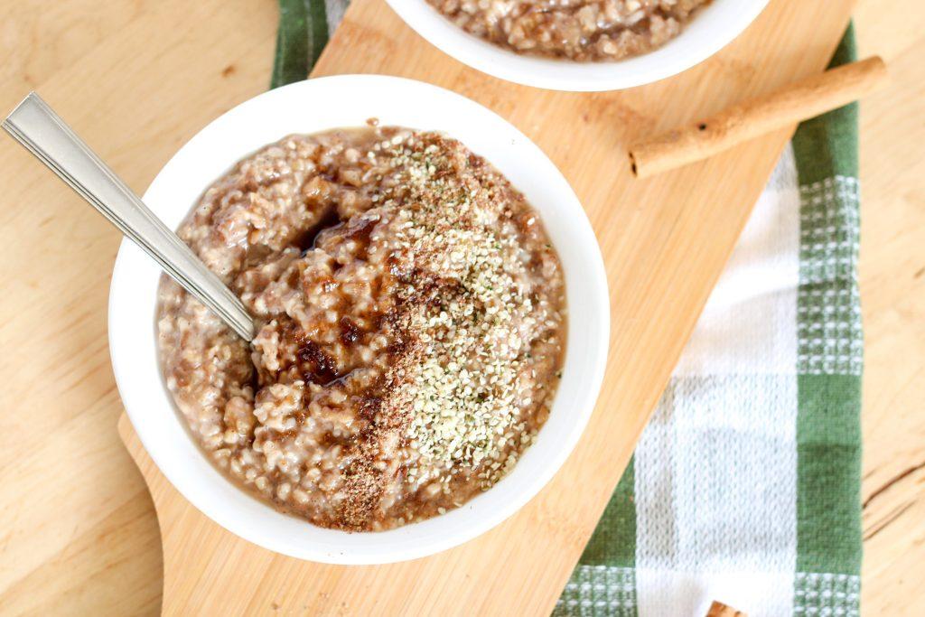 bowl of oatmeal and cinnamon sticks