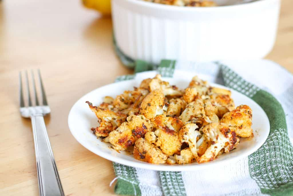 plate of roasted cauliflower and fork