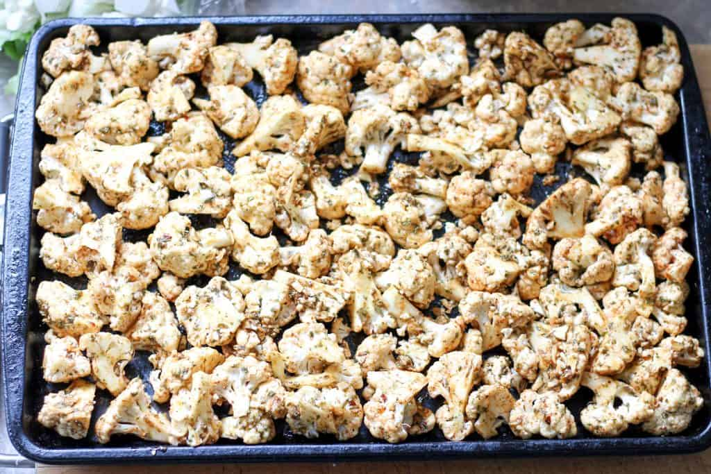 cauliflower on pan ready for roasting