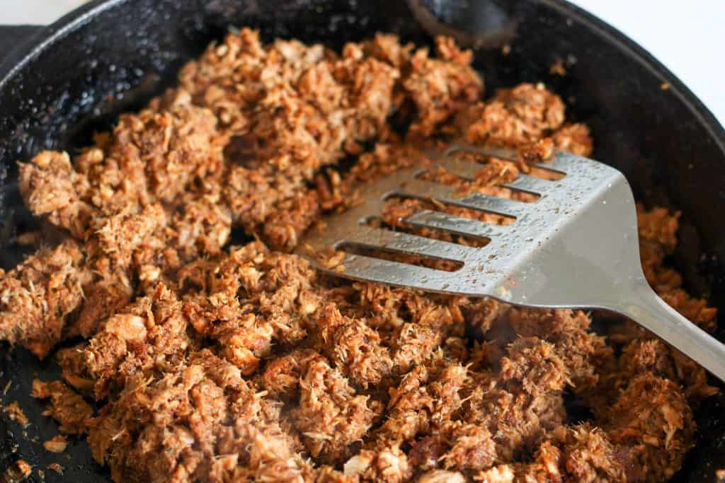 stirring spices into canned tuna