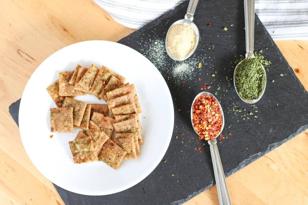 crackers on plate and spoons with different spices