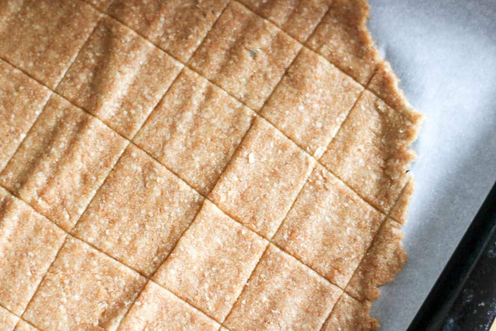 square crackers on cookie sheet before baking