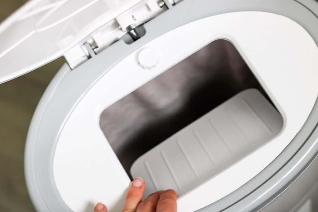 diaper pail lid up and trap door open