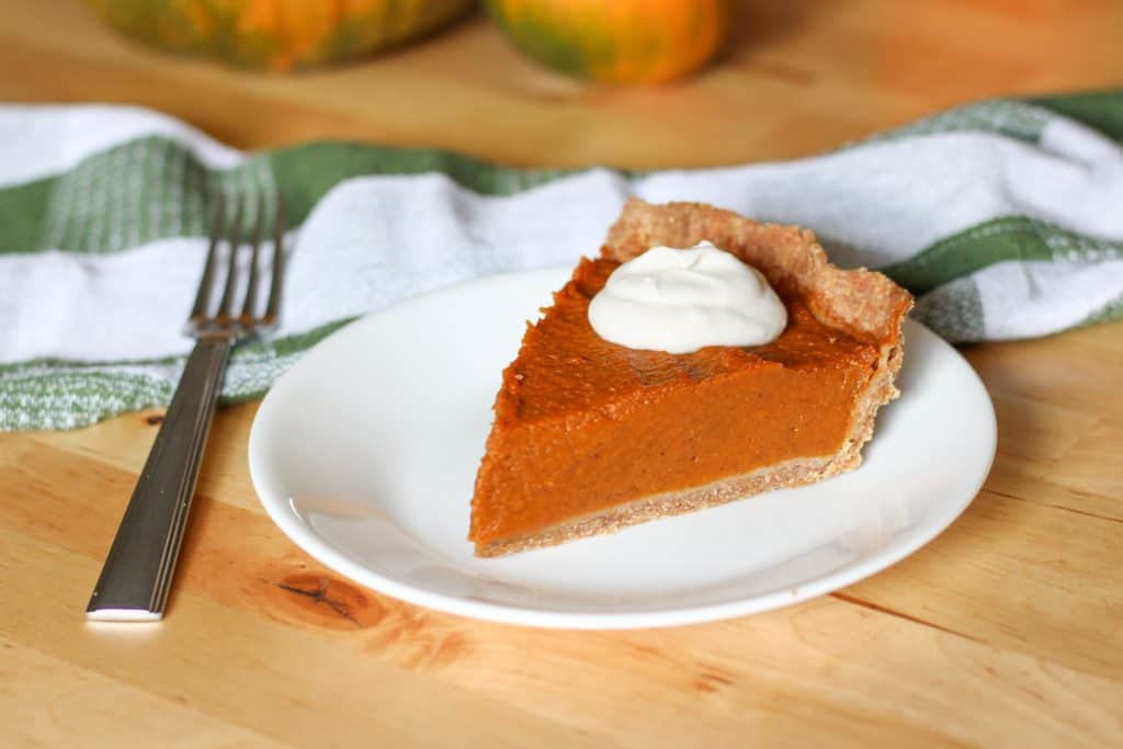 piece of pumpkin pie on plate and fork