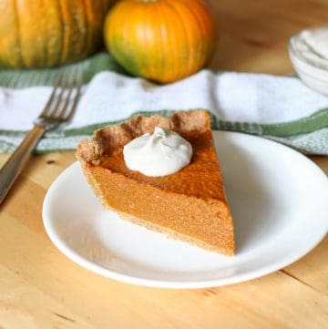 slice of pumpkin pie on plate and fork