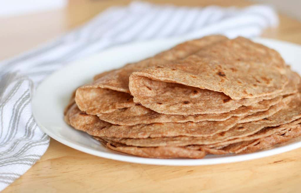 folded sprouted wheat tortillas in plate