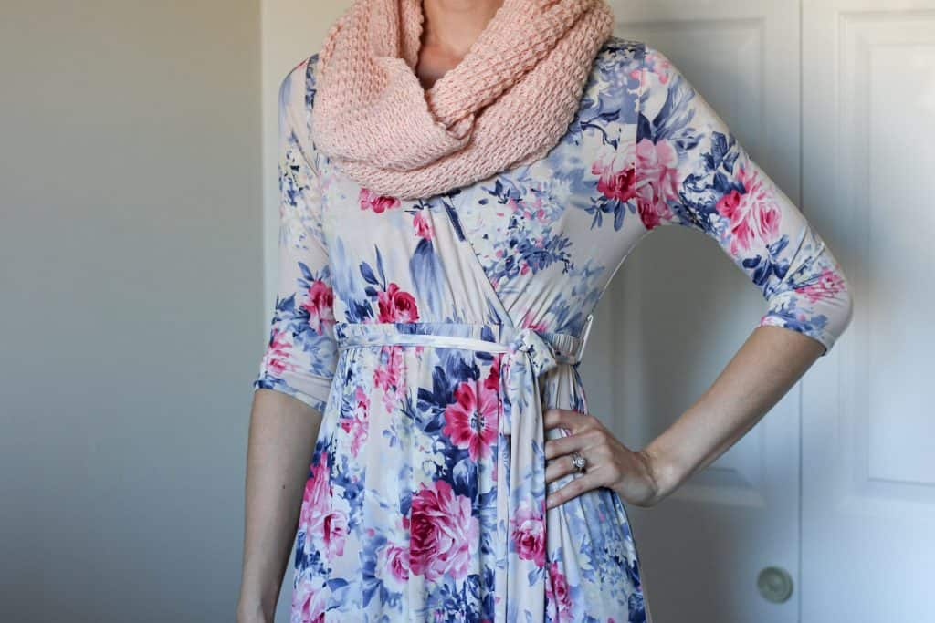 womna wearing wrap dress and scarf